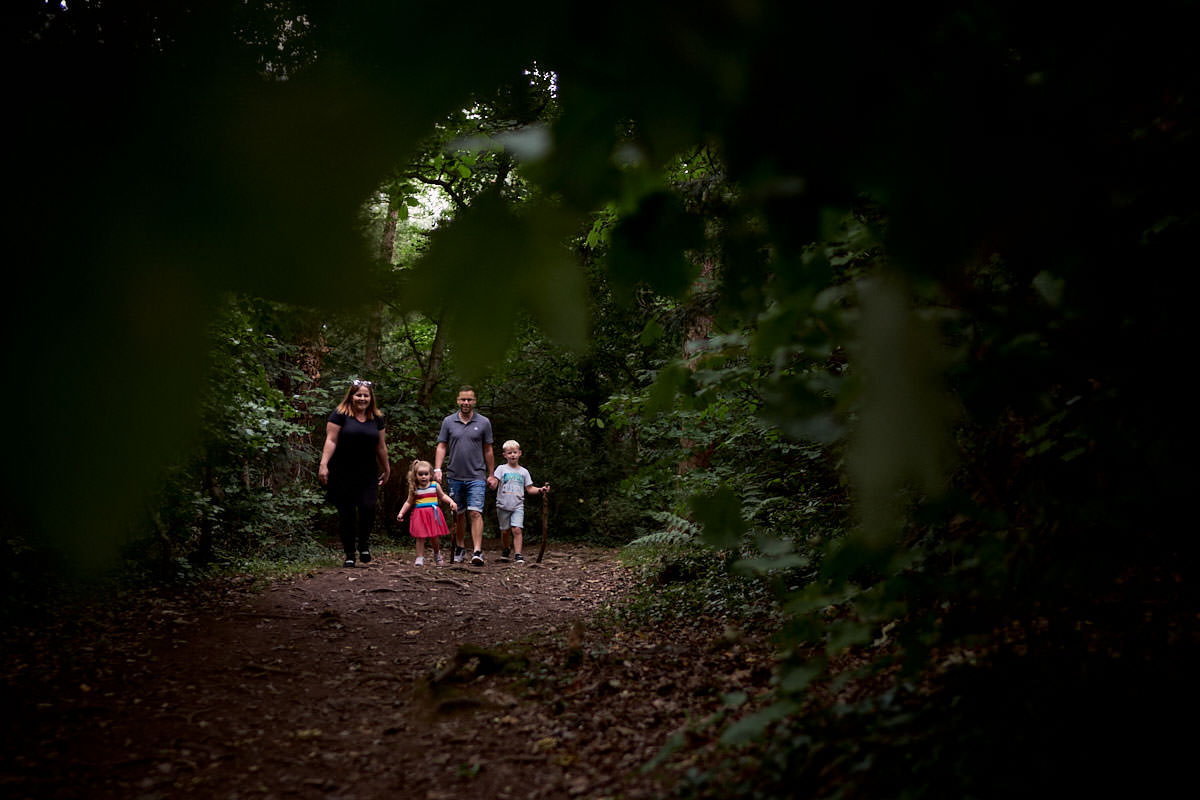 family exploring in the woods