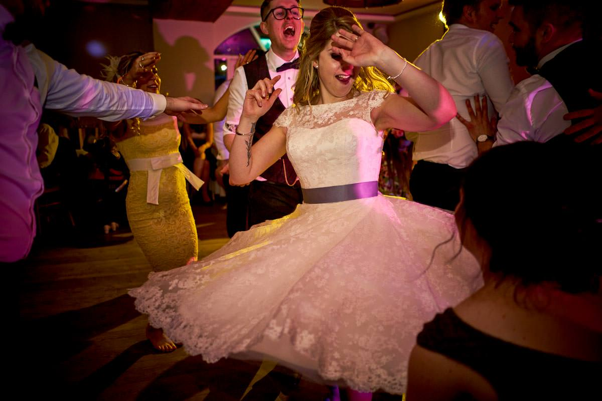 Bride twirling and spinning her short wedding dress