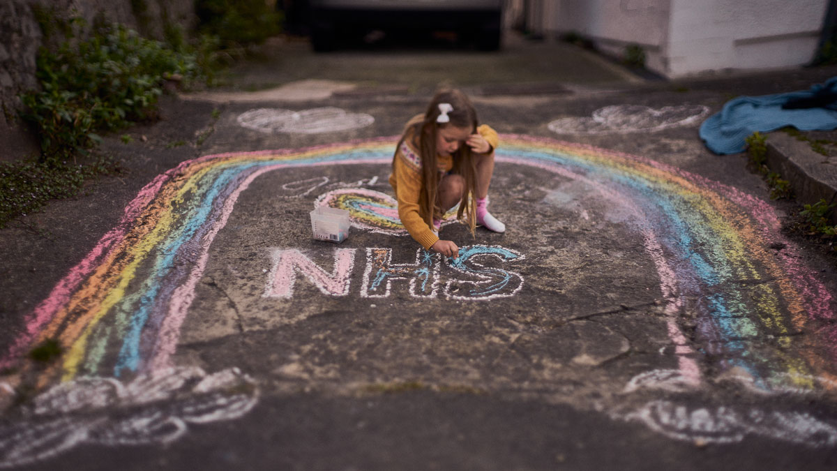 My daughter drawing a rainbow for the NHS during Civid 19